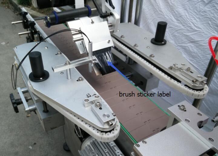 Automaatne ümmarguse pudeli kleebise märgistamise masin õllepudeliga öeldud mootori jaoks