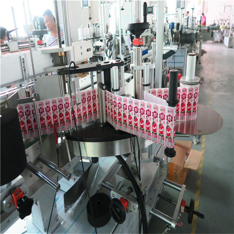 Kleebise siltide aplikaator esiosa tagaküljele ja keerake etiketi pudel ümber